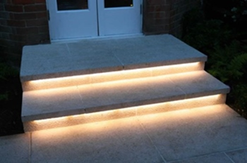 Linear LED lighting on outdoor entryway steps